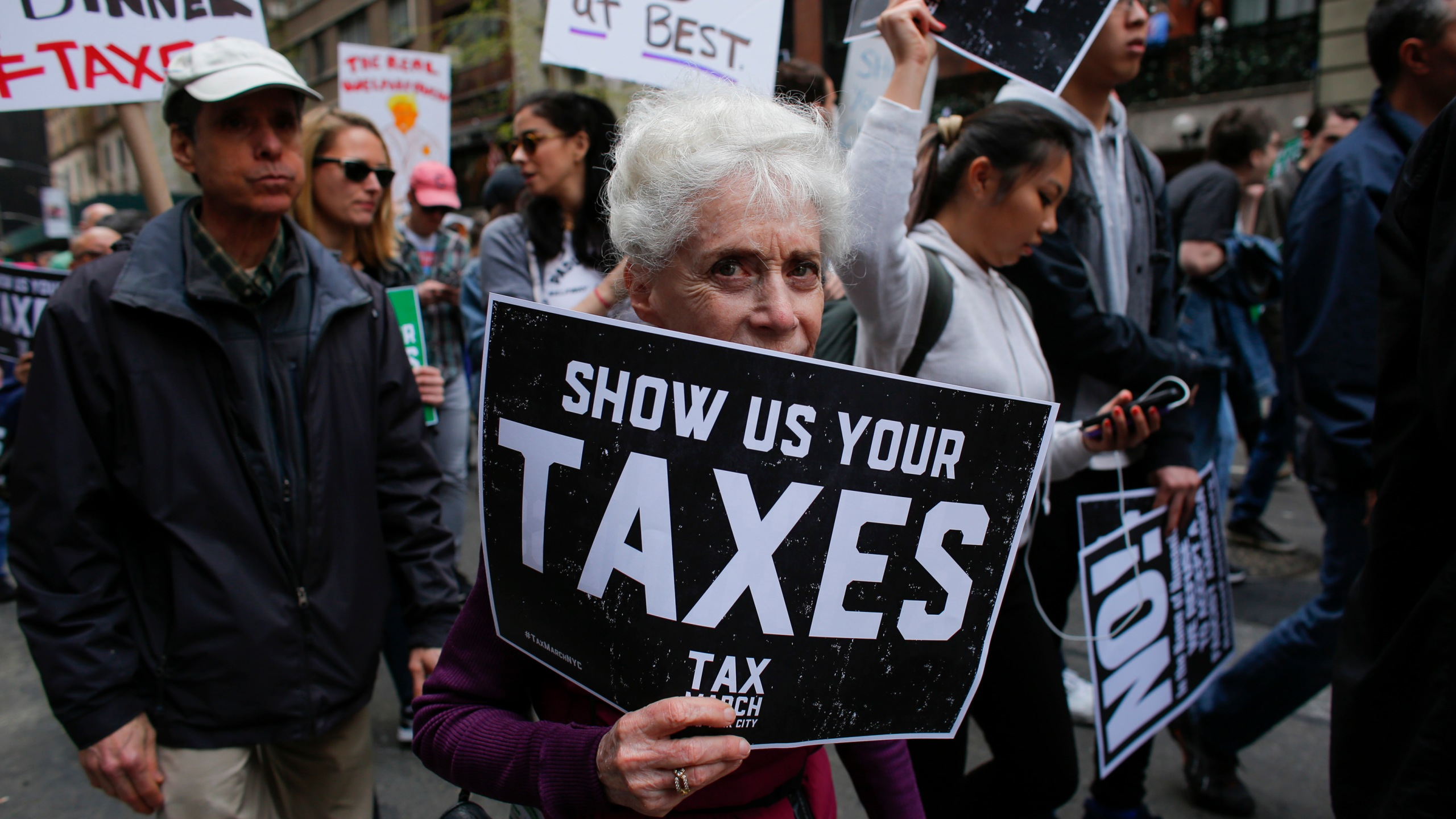 "Protesters take part in the ""Tax March"" calling on Donald Trump to release his tax records on April 15, 2017 in New York. (KENA BETANCUR/AFP/Getty Images)"