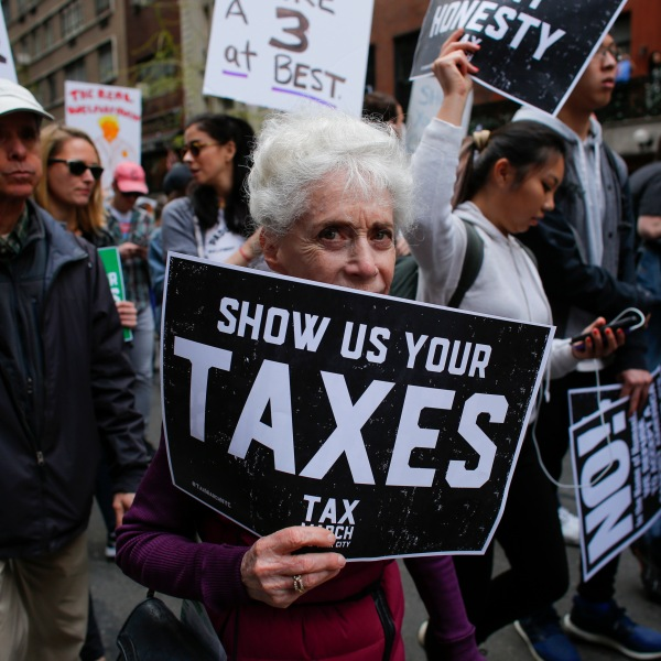 """Protestors take part in the """"Tax March"""" calling on Donald Trump to release his tax records on April 15, 2017 in New York. (Credit: KENA BETANCUR/AFP/Getty Images)"""