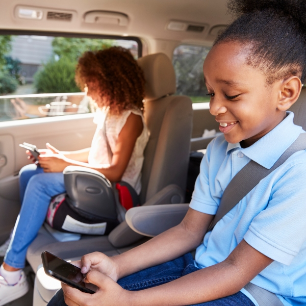 Children are seen in a booster seat in this file photo. (Credit: iStock / Getty Images Plus)