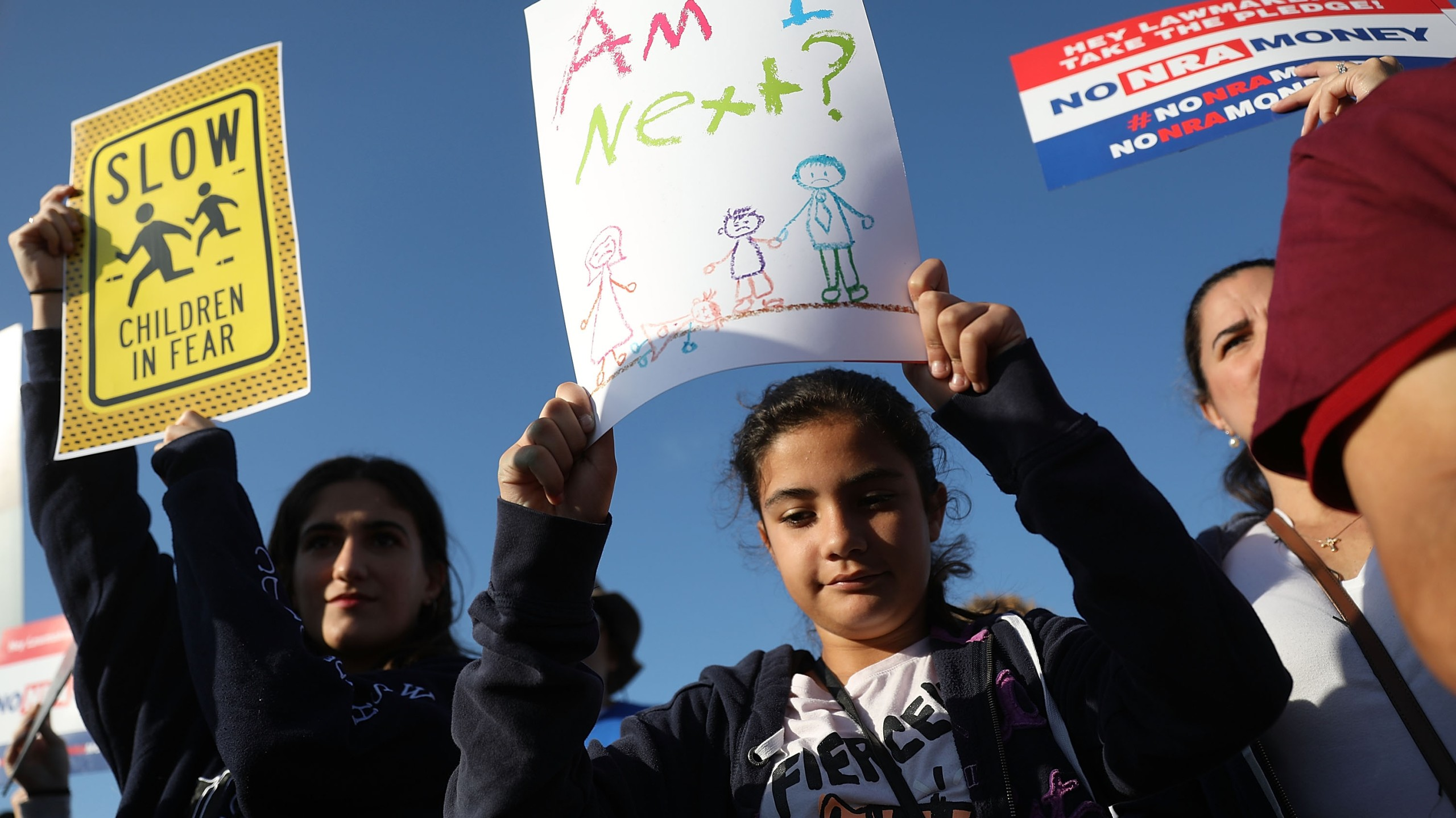 Cassandra Perry and Bianca Torres participate in the March For Our Lives event at Pine Trails Park before walking to Marjory Stoneman Douglas High School on March 24, 2018. (Credit: Joe Raedle/Getty Images)