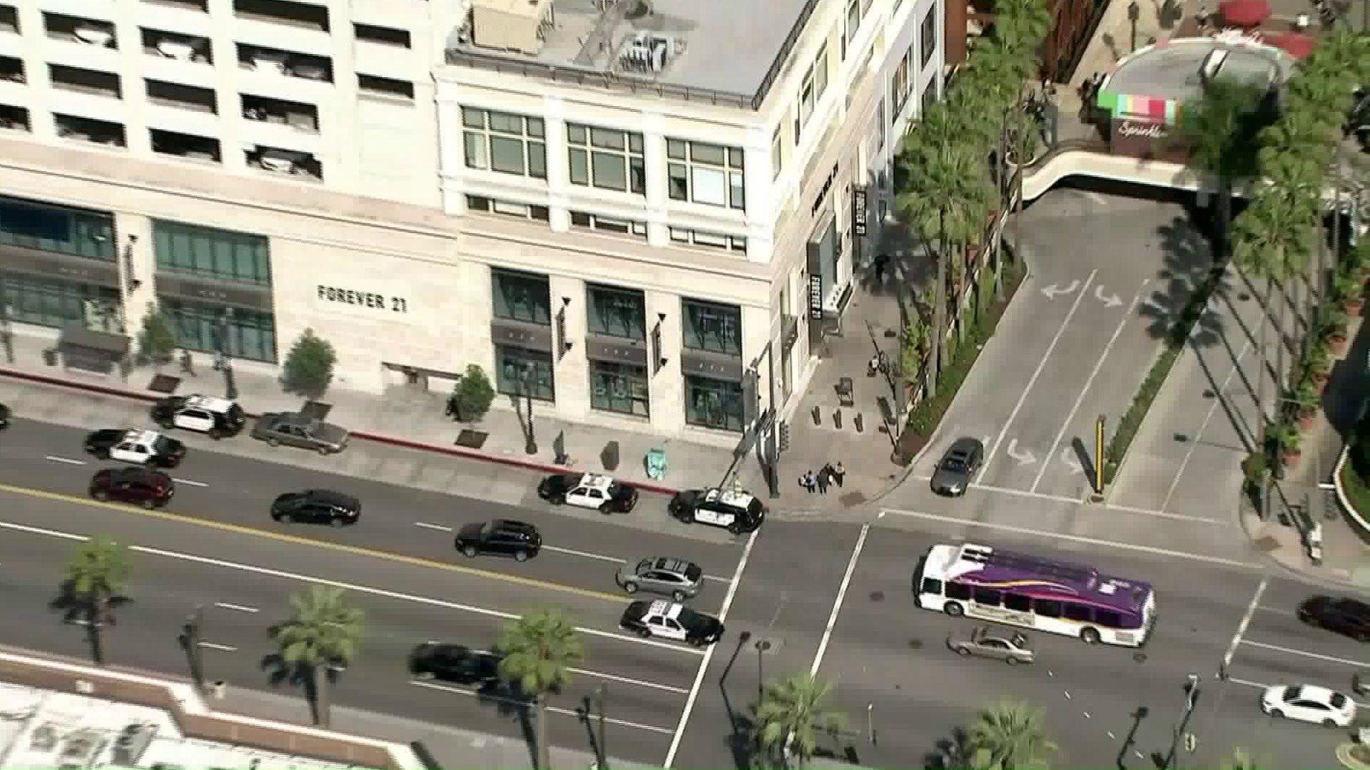 Police respond to the Americana at Brand mall in Glendale after a man jumped from a roof there and landed on another man on April 2, 2019. (Credit: KTLA)