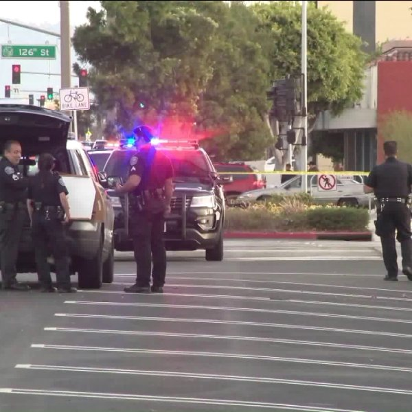Police investigate a fatal shooting in front of the Hawthorne Police Department on April 7, 2019. (Credit: KTLA)