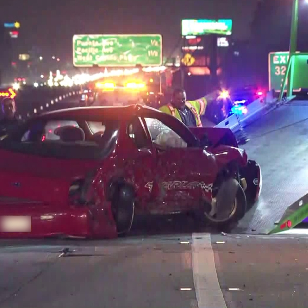 A tow truck moves a vehicle following a crash on the 10 Freeway on April 26, 2019. (Credit: KTLA)