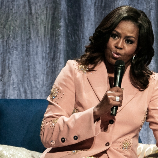 """Former first lady Michelle Obama speaks on stage of the Royal Arena in Copenhagen on April 9, 2019, during a tour to promote her memoir """"Becoming."""" (Credit: MARTIN SYLVEST/AFP/Getty Images)"""