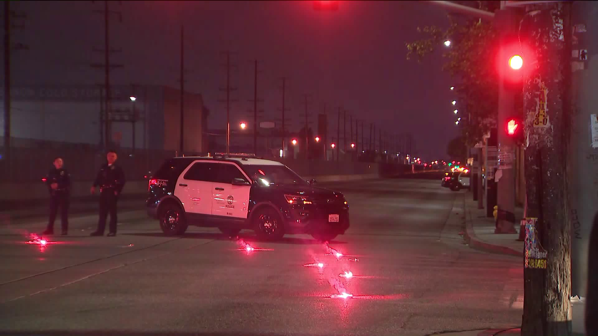 Authorities investigate the scene of a shooting at Long Beach Avenue and 51st Street in South Los Angeles on April 20, 2019. (Credit: KTLA)