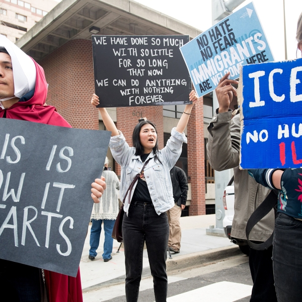 People protest outside a speech by Attorney General Jeff Sessions March 7, 2018, in Sacramento. (Credit: NOAH BERGER/AFP/Getty Images)
