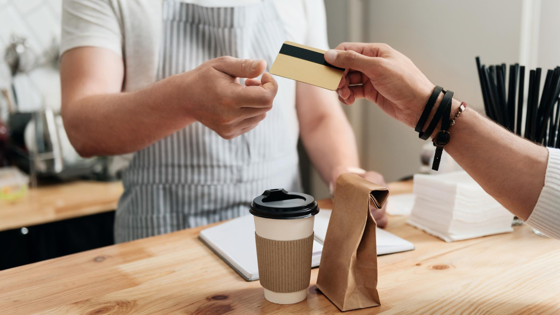A customer pays at a restaurant in this file photo. (Credit: Shutterstock via CNN Wire)