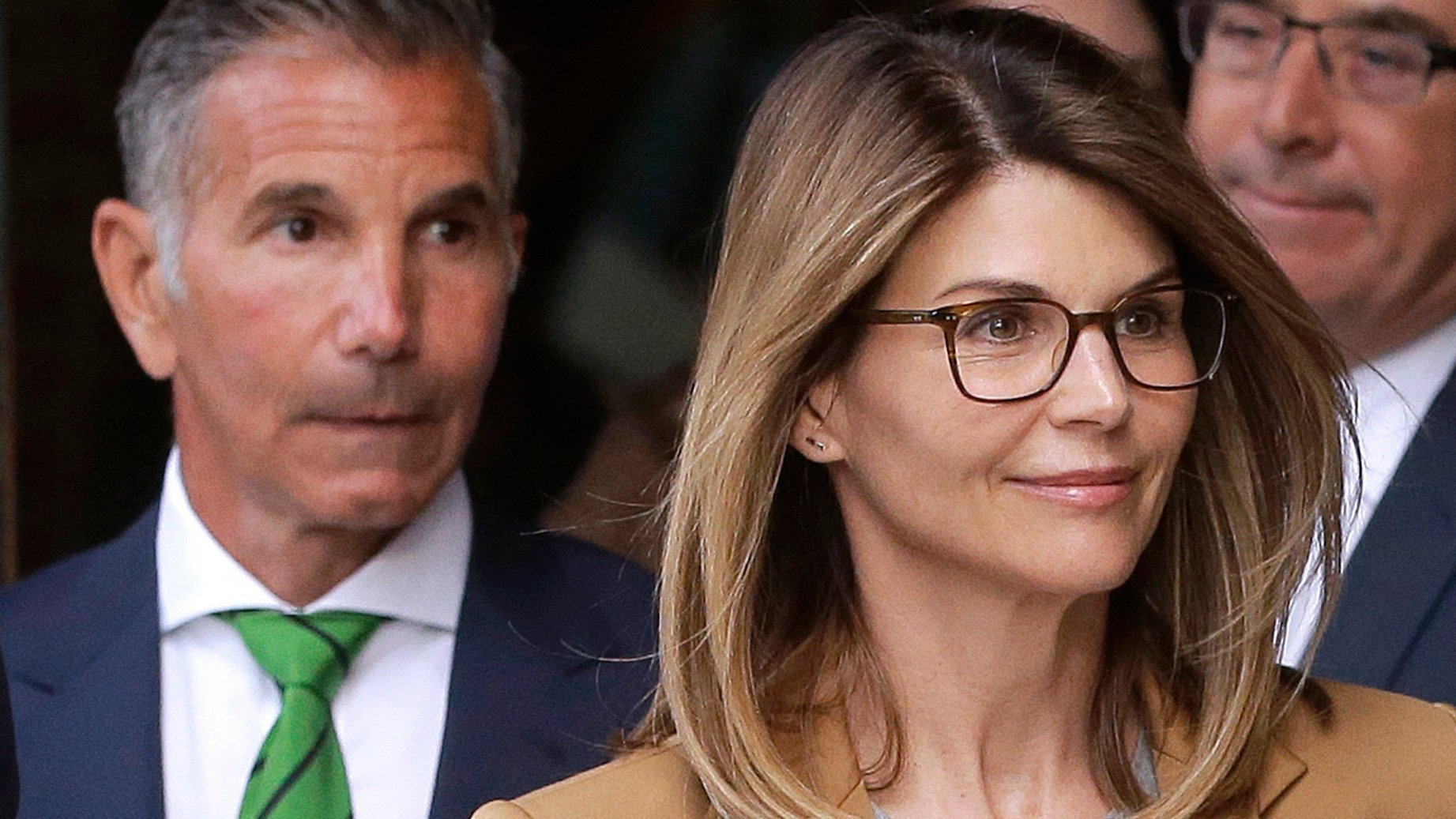 Fashion designer Mossimo Giannulli, left, leaves a federal courthouse in Boston behind his wife, actress Lori Loughlin, on April 3, 2019. (Pat Greenhouse / The Boston Globe via Getty Images)