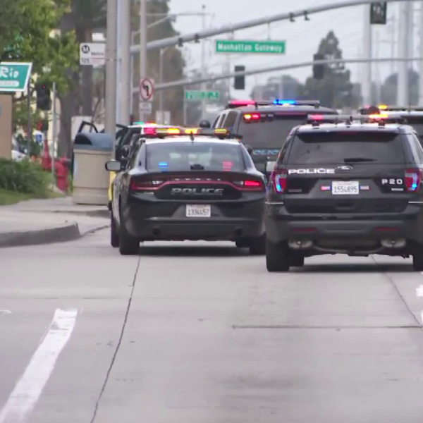 Police respond to an officer-involved shooting near the Hawthorne and Manhattan Beach border on April 7, 2019. (Credit: KTLA)