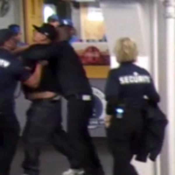 Security guards appear to grab a fan in surveillance video from Dodger Stadium on April 24, 2018, provided by the diDonato Law Center.