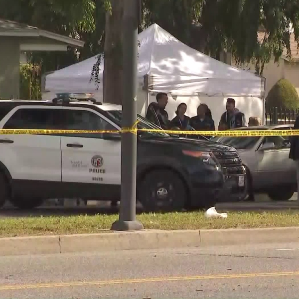 Police investigate after a man was found dead in his car in South Los Angeles on April 15, 2019. (Credit: KTLA)