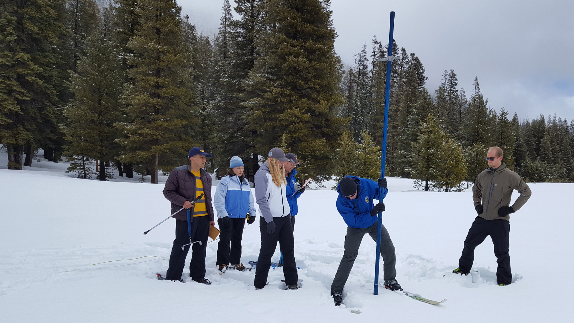 A team from the Department of Water Resources conducts the fourth snow survey of the year at Phillips Station on April 1, 2019. (Credit: DWR)