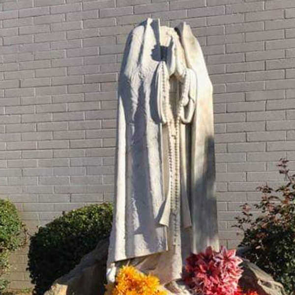 A vandalized statue is seen at St. Margaret Mary Catholic Church in Chino. (Credit: Luis Calvo)