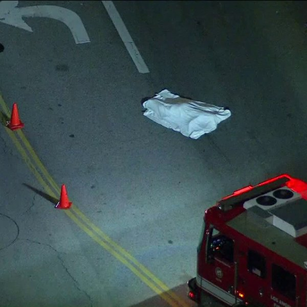 Police investigate a hit-and-run collision that left a bicyclist dead at San Fernando Road and Penrose Street in Sun Valley on April 18, 2019. (Credit: KTLA)