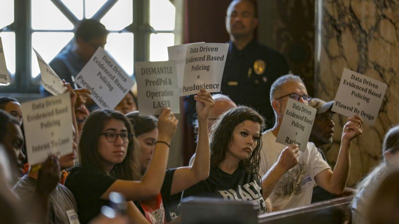 Protesters attend the Los Angeles Police Commission's special meeting on the LAPD's use of data in policing. (Credit: Irfan Khan/Los Angeles Times)