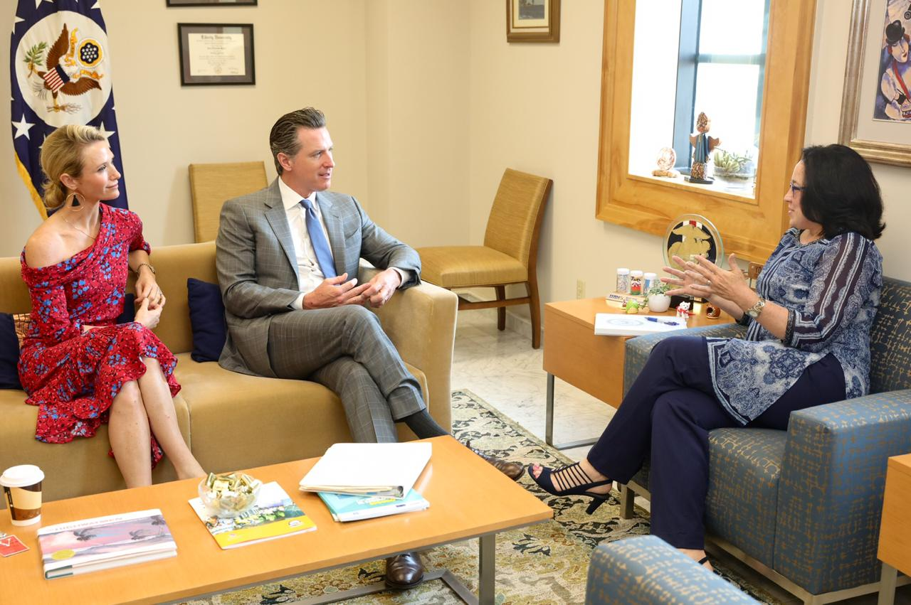 California Gov. Gavin Newsom, center, and his wife, Jennifer Siebel Newsom, left, speaks with U.S. Ambassador to El Salvador Jean Manes in a photo tweeted by the ambassador on April 8, 2019.