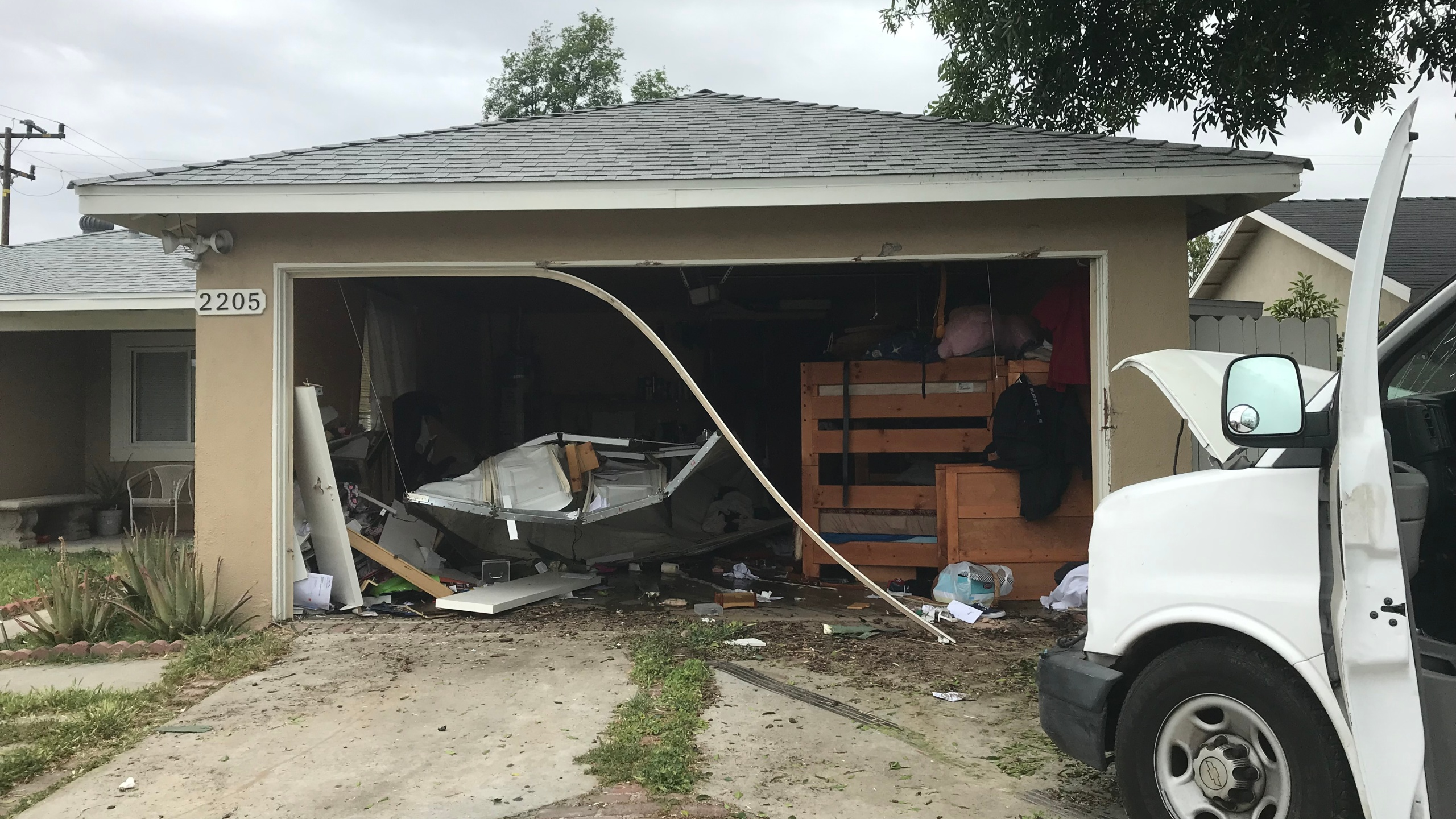 The garage of a Simi Valley home is seen after a suspected intoxicated driver crashed into it on April 30, 2019, in a photo released by the Simi Valley Police Department.