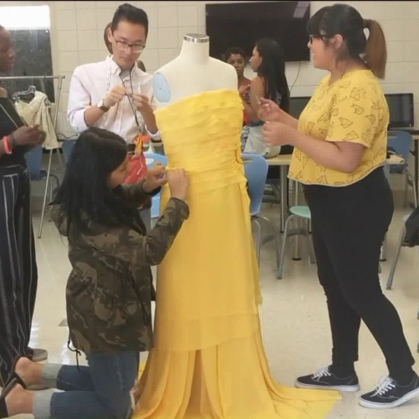 Designers are seen working on a dress for Freedom and Fashion. (Credit: KTLA)