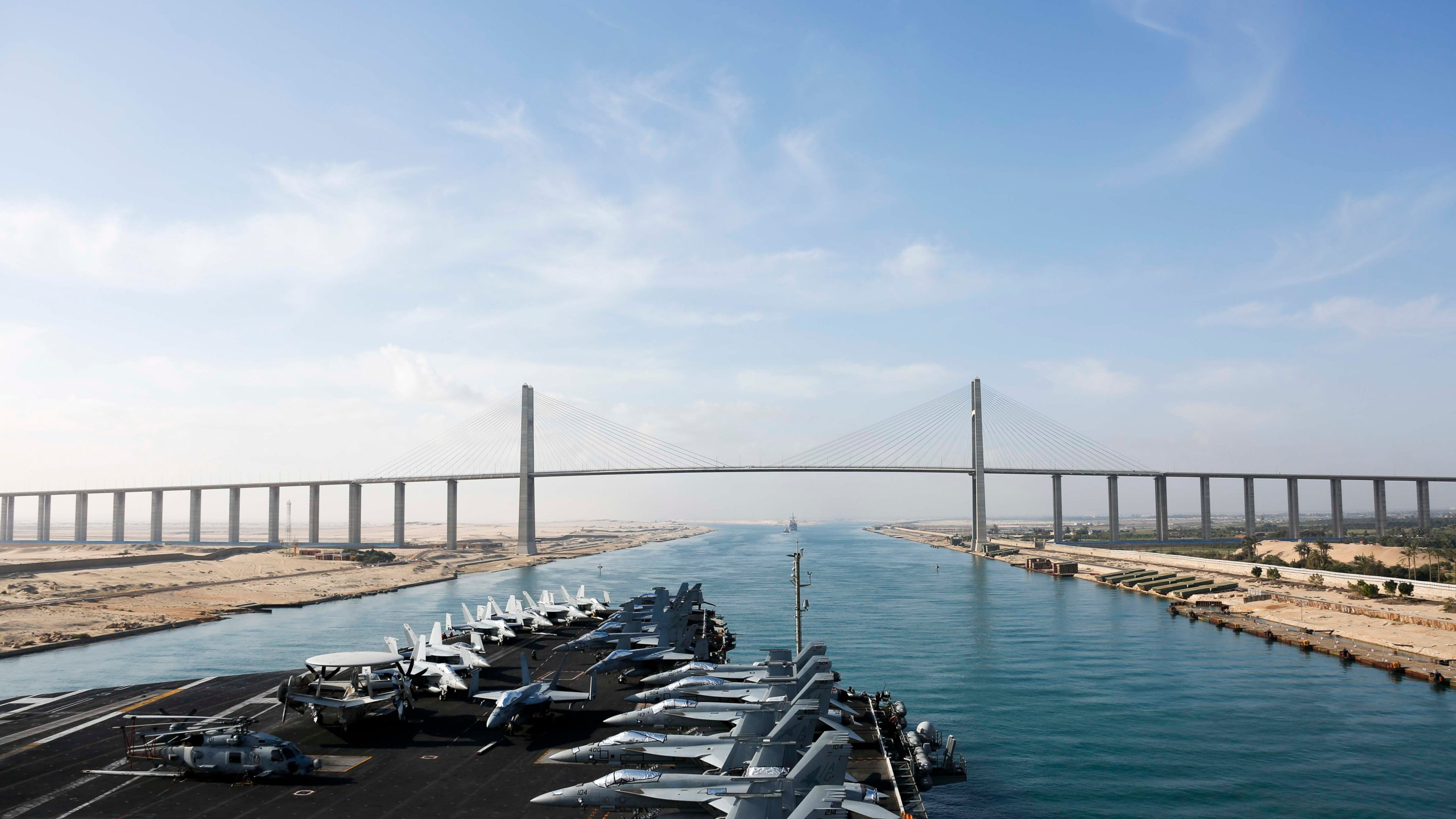 In this May 9, 2019 photo released by the U.S. Navy, the Nimitz-class aircraft carrier USS Abraham Lincoln transits the Suez Canal in Egypt. The aircraft carrier and its strike group are deploying to the Persian Gulf on orders from the White House to respond to an unspecified threat from Iran.