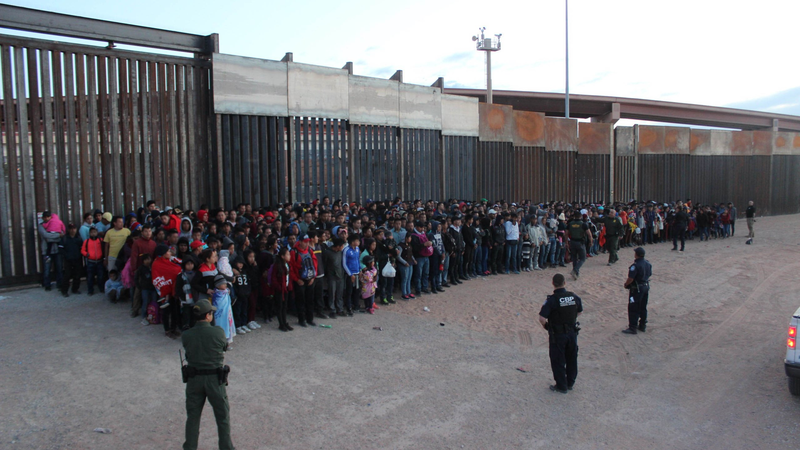 This May 29, 2019, photo released by U.S. Customs and Border Protection shows some of 1,036 migrants who crossed the U.S.-Mexico border in El Paso, Texas, the largest that the Border Patrol says it has ever encountered.