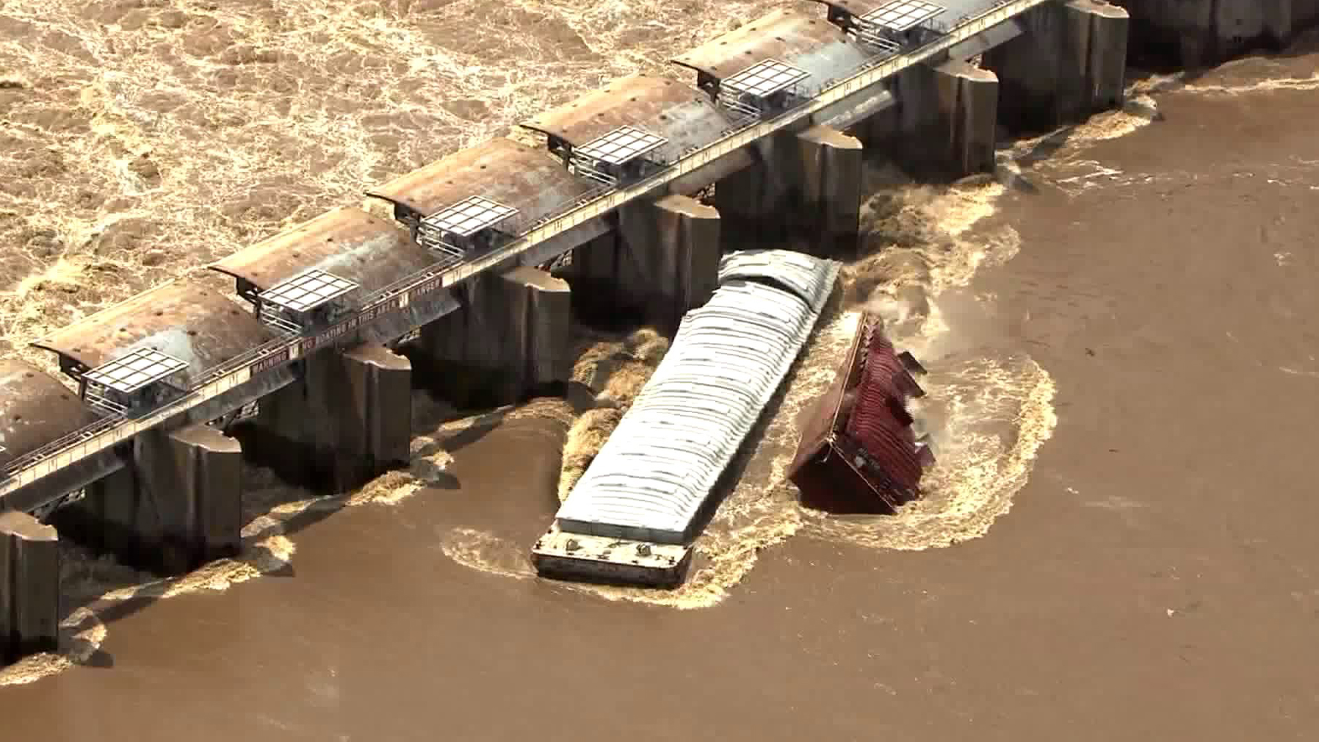 Two barges sank in the Arkansas River after crashing into the Webbers Falls Lock & Dam in Oklahoma on May 23, 2019. (Credit: KFOR)