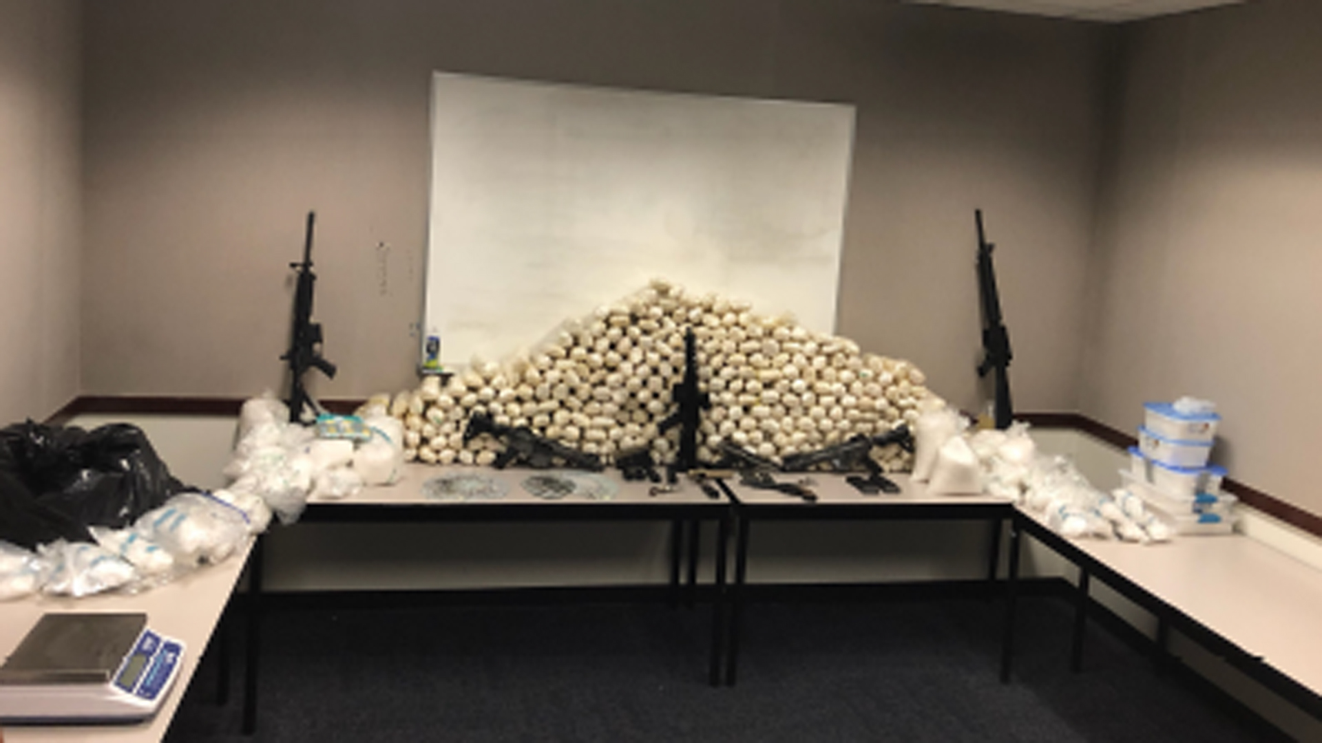 Alhambra police released this photo of drugs and weapons that were seized during the investigation.