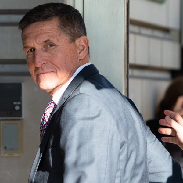Less redacted versions of memos released Thursday from the court record in Michael Flynn's criminal case reveal more details of Flynn's cooperation with special counsel Robert Mueller. (Credit: Saul Loeb/Getty Images)