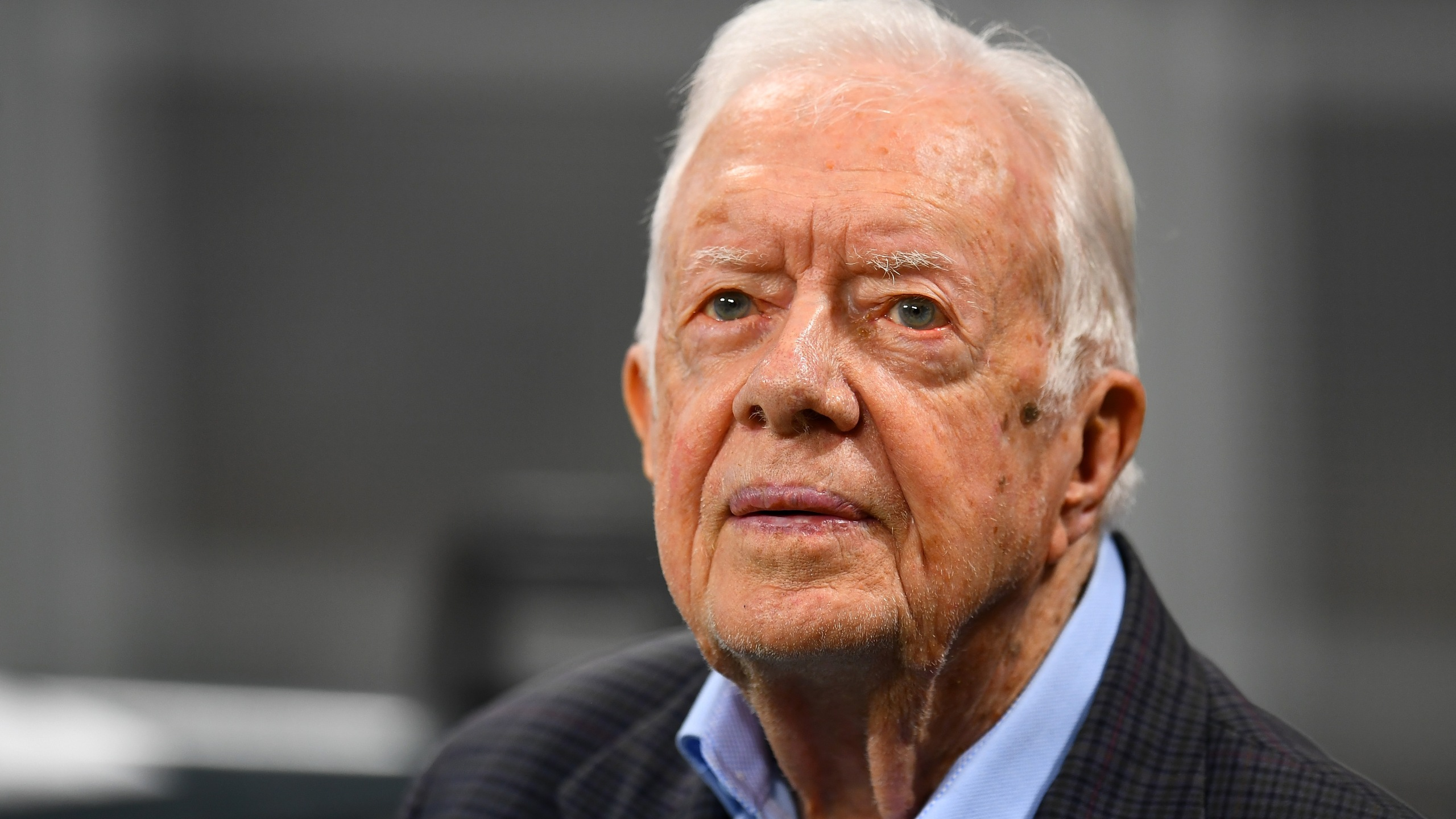 Former president Jimmy Carter looks on before a game between the Atlanta Falcons and the Cincinnati Bengals at Mercedes-Benz Stadium in Atlanta on Sept. 30, 2018. (Credit: Scott Cunningham/Getty Images)
