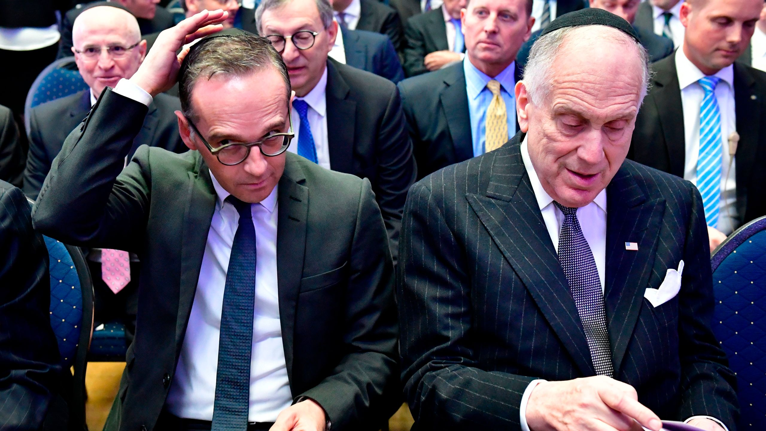 Foreign minister Heiko Maas (L) adjusts his Jewish kippa skullcap next to the President of the World Jewish Congress Ronald Lauder prior the solemn ordination ceremony of three rabbis and three cantors at the Bet Zion synagogue in Berlin, Germany, on Oct. 8, 2018. (Credit: Tobias SCHWARZ / AFP) /Getty Images)