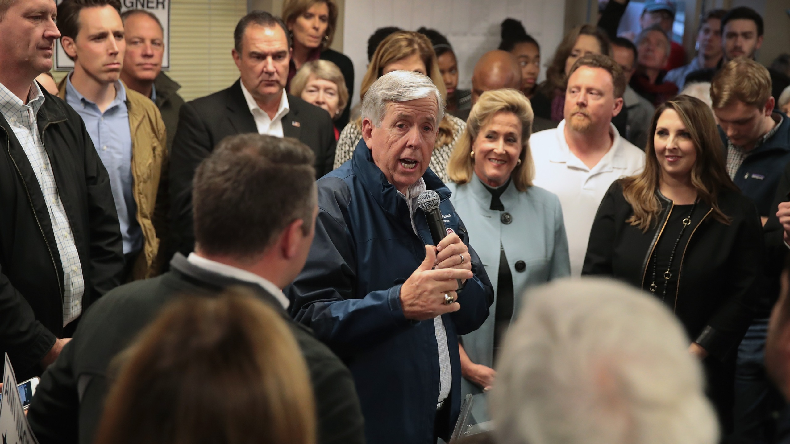 Missouri Governor Mike Parson speaks in support of Republican U.S. Senate candidate Josh Hawley (2nd from L) during a campaign rally at the MOGOP field Office on November 5, 2018 in St. Louis, Missouri. (Credit: Scott Olson/Getty Images)