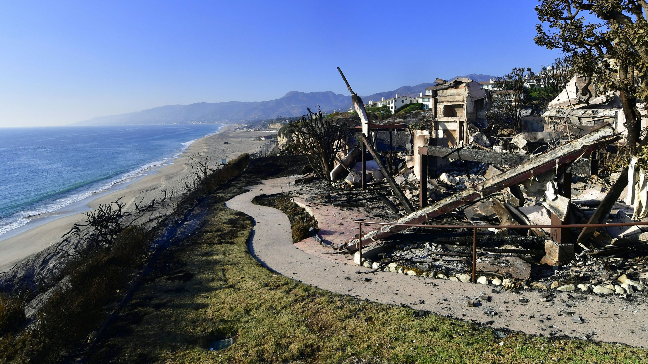 This photo shows the remains of a beachside luxury home along the Pacific Coast Highway community of Point Dume in Malibu on Nov. 11, 2018, as the battle to control the Woolsey Fire continues. (Credit: Frederic J. Brown / AFP / Getty Images)