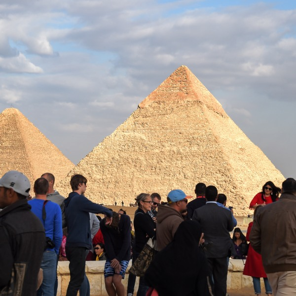 Tourists gather at the Giza pyramids necropolis in Egypt on Dec. 29, 2018, with the pyramids of Khafre and Khufu seen in the background. (Credit: MOHAMED EL-SHAHED/AFP/Getty Images)