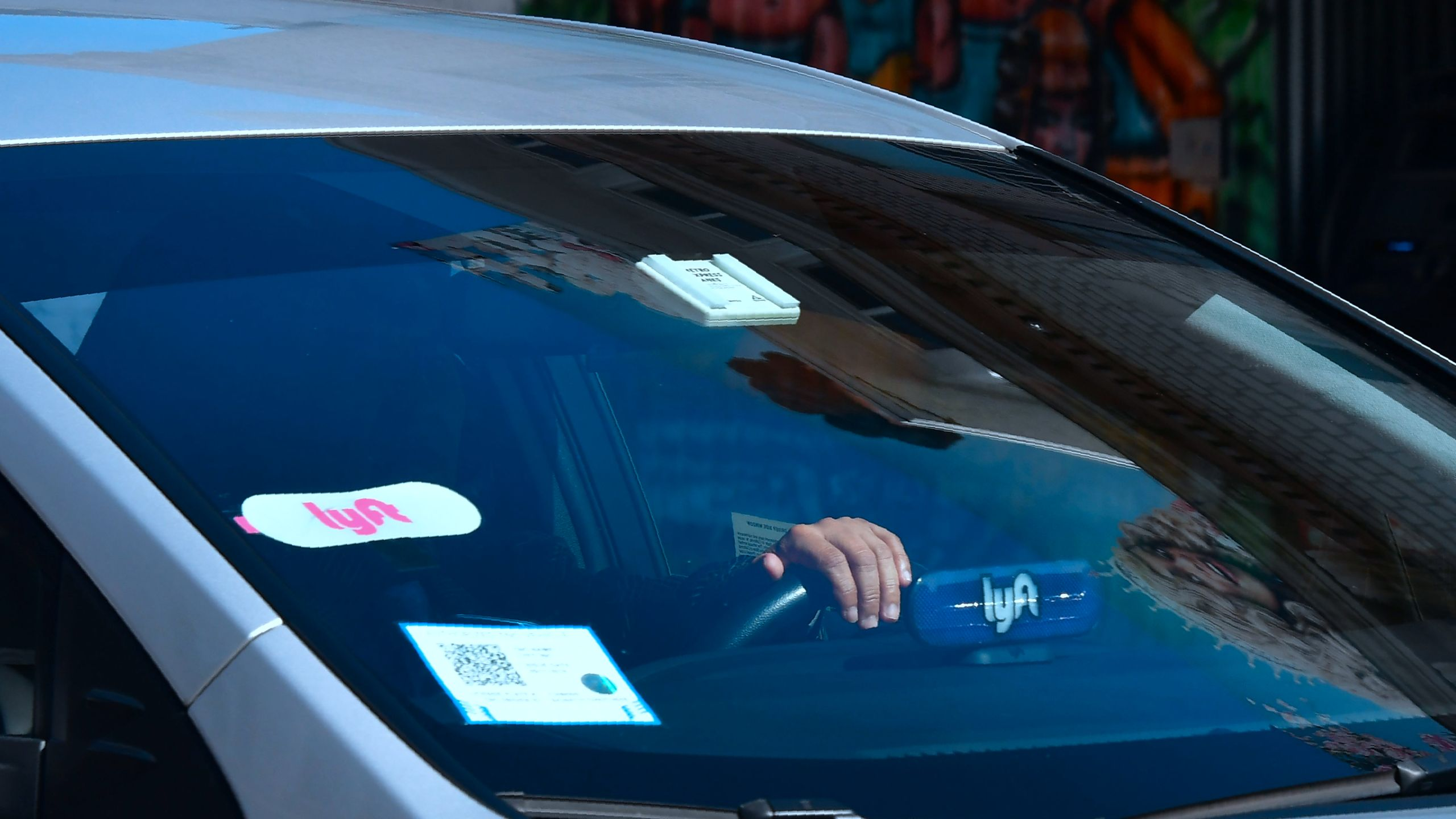 A driver with the Lyft decal on his vehicle cruises Hollywood on Feb. 21, 2019. (Credit: Frederic J. Brown / AFP / Getty Images)