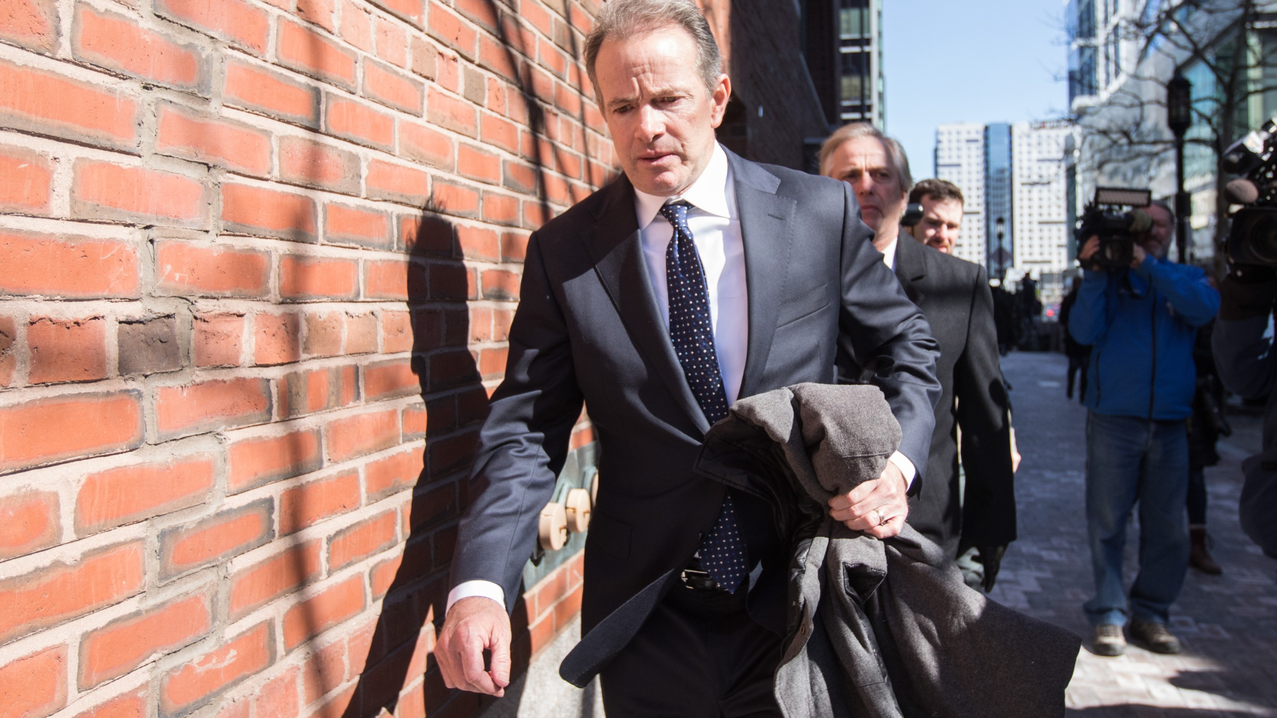 Gordon Ernst, former head coach of the men's and women's tennis teams at Georgetown University, leaves following his arraignment at Boston Federal Court on March 25, 2019 in Boston, Mass. (Credit: Scott Eisen/Getty Images)