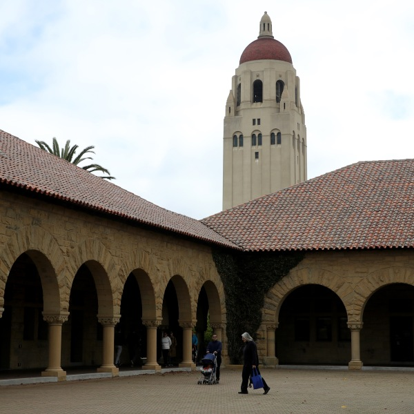 People walk by Hoover Tower on the Stanford University campus on March 12, 2019. (Credit: Justin Sullivan / Getty Images)