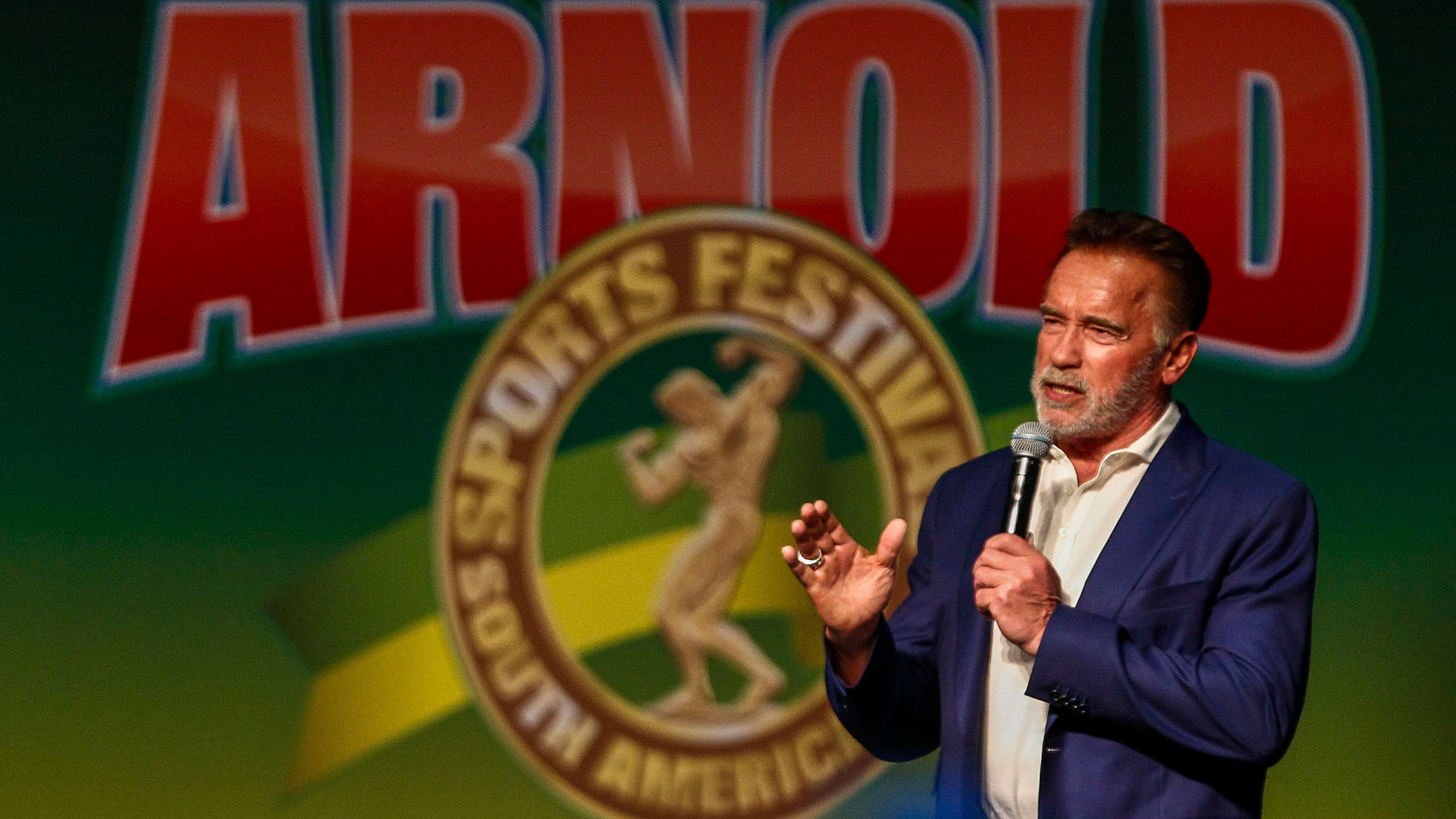 Former California Gov. Arnold Schwarzenegger speaks during the opening of the fitness and bodybuilding Arnold Classic Brazil event in Sao Paulo, Brazil, on April 12, 2019. (Credit: MIGUEL SCHINCARIOL/AFP/Getty Images)