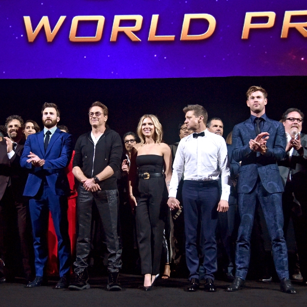 "Director Anthony Russo, Mark Ruffalo, Chris Evans, Robert Downey Jr., Scarlett Johansson, Jeremy Renner, Chris Hemsworth, Executive Producer Jon Favreau, and President of Marvel Studios/Producer Kevin Feige speak onstage during the world premiere ""Avengers: Endgame"" at the Los Angeles Convention Center on April 23, 2019. (Credit: Alberto E. Rodriguez/Getty Images for Disney)"