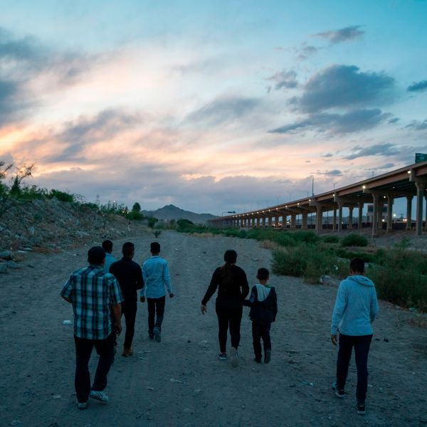 Migrants attempt to enter the U.S. between Ciudad Juarez, Mexico, and El Paso, Texas, on April 29, 2019. (Credit: Paul Ratje / AFP / Getty Images)