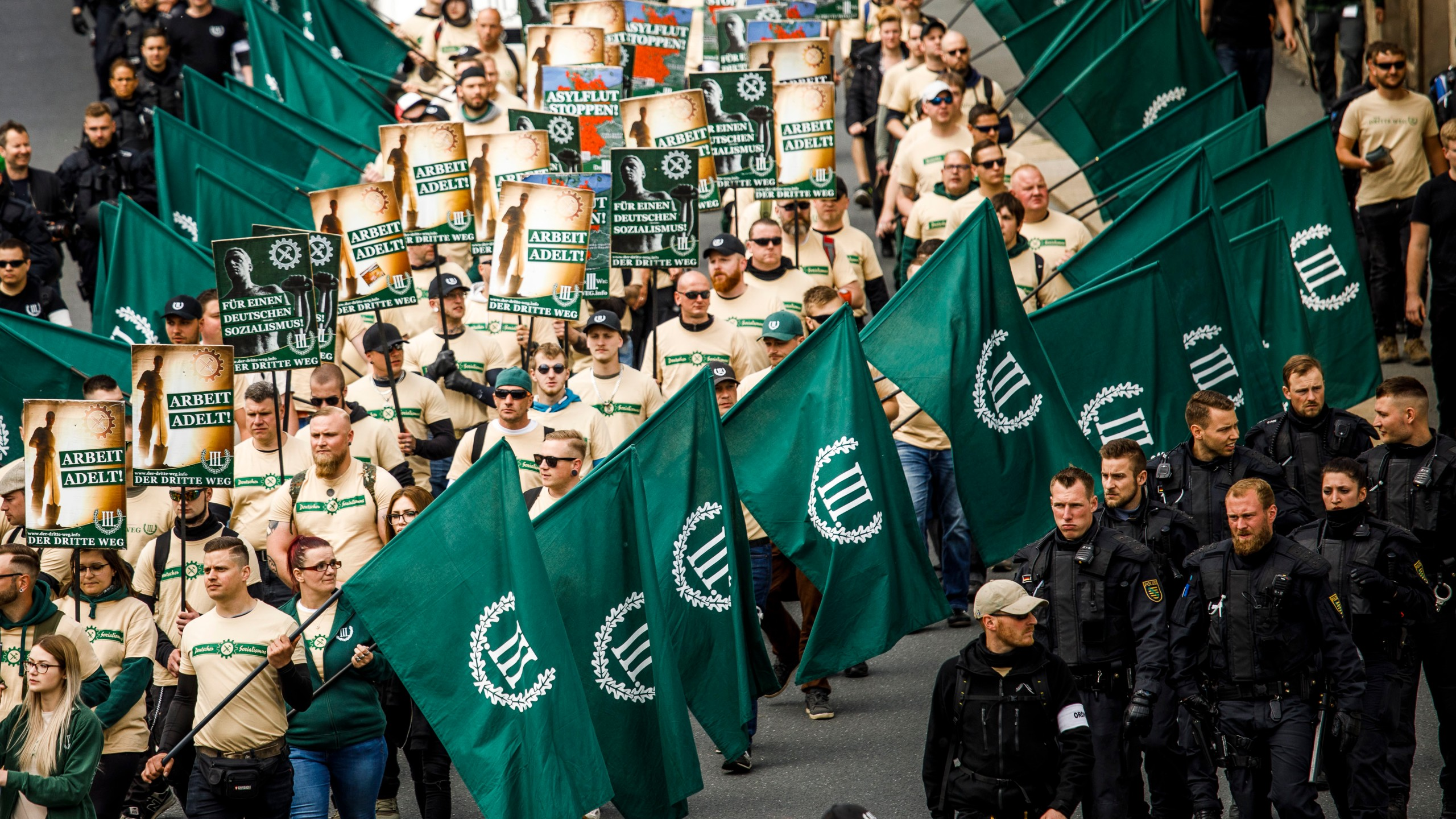 Supporters of the far-right The Third Way (Der Dritte Weg) movement march on May Day on May 1, 2019, in Plauen, Germany. (Credit: Carsten Koall/Getty Images)