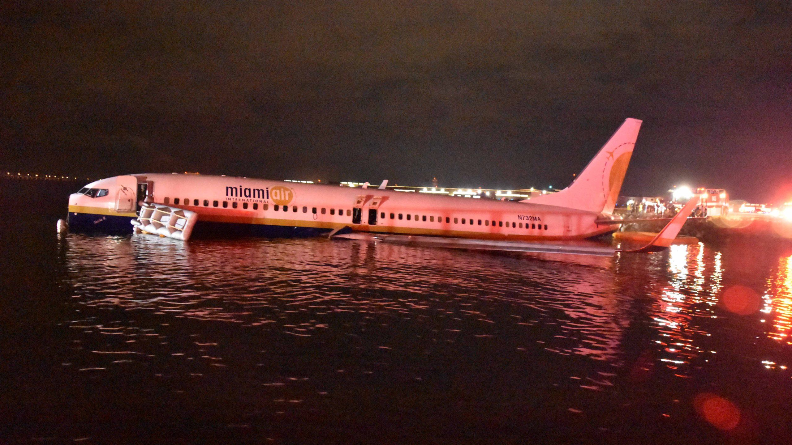 In this handout released by the U.S. Navy, a Boeing 737 aircraft carrying 136 passengers and seven crew from Naval Station Guantanamo Bay, Cuba, slid off the runway at Naval Air Station Jacksonville, Fla. into the St. Johns River, May 3, 2019. (Credit: U.S. Navy via Getty Images)