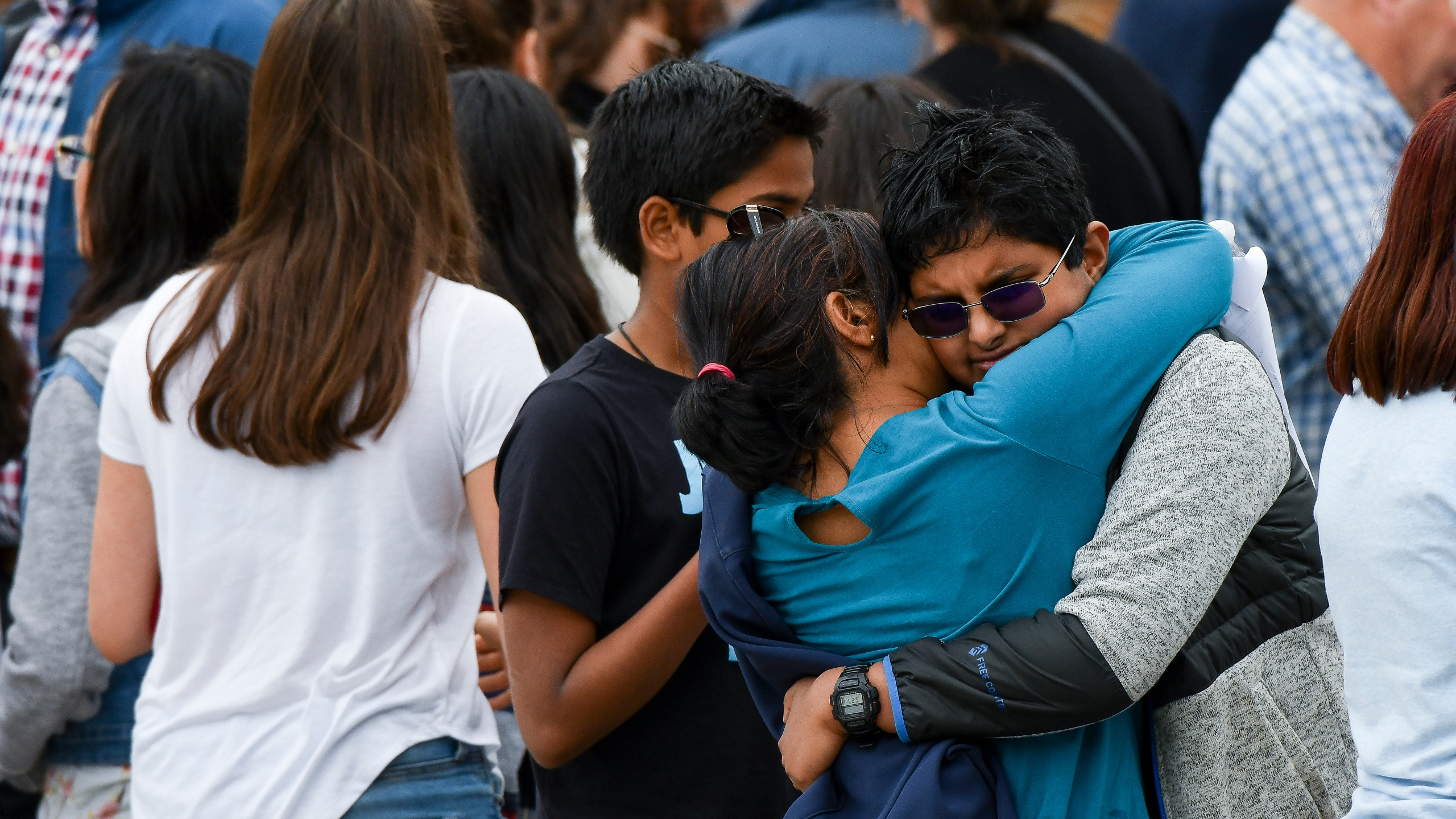 Students are reunited with their parents after being evacuated after at least seven students were injured during a shooting at STEM School Highlands Ranch in Highlands Ranch, Colorado, on May 7, 2019. (Credit: Michael Ciaglo / Getty Images)