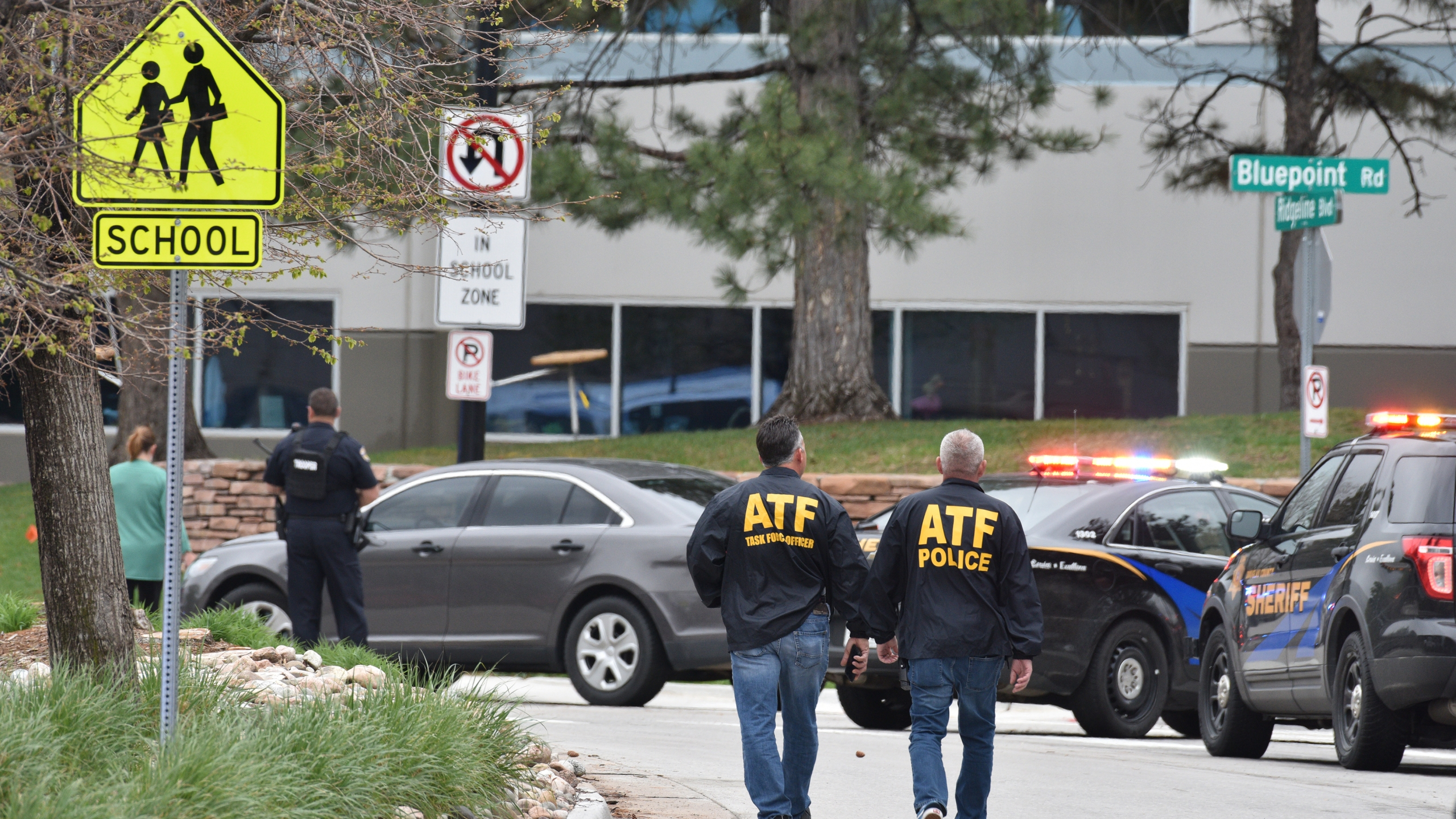 ATF officers walk arrive on the scene of a shooting at the STEM School Highlands Ranch on May 7, 2019 in Highlands Ranch, Colorado. (Credit: Tom Cooper/Getty Images)