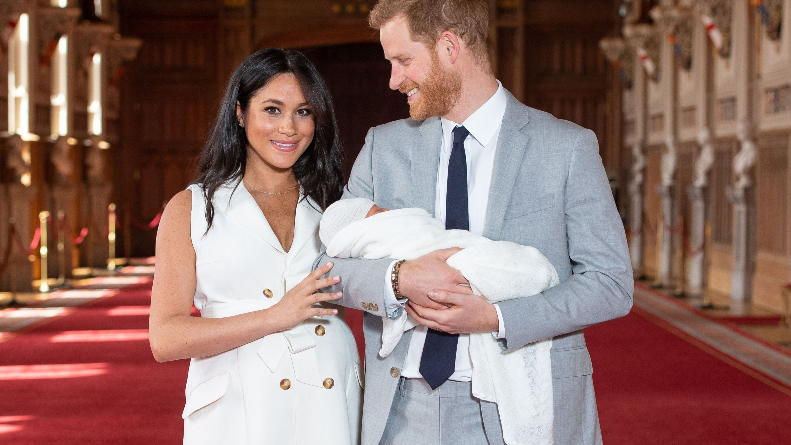 Britain's Prince Harry, Duke of Sussex (R), and his wife Meghan, Duchess of Sussex, pose for a photo with their newborn baby son in St George's Hall at Windsor Castle in Windsor, west of London on May 8, 2019. (Credit: DOMINIC LIPINSKI/AFP/Getty Images)
