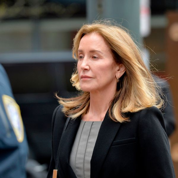 Actress Felicity Huffman is escorted by police into court where she pleaded guilty to one count of conspiracy to commit mail fraud and honest services mail fraud in the college admissions scandal in Boston on May 13, 2019. (Credit: JOSEPH PREZIOSO/AFP/Getty Images)