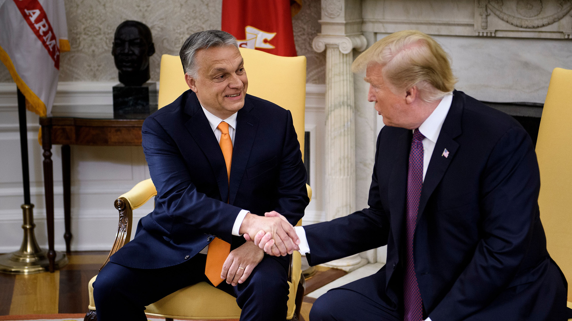 Hungary's Prime Minister Viktor Orban and President Donald Trump shake hands before a meeting in the Oval Office of the White House May 13, 2019, in Washington, DC. (Credit: BRENDAN SMIALOWSKI/AFP/Getty Images)