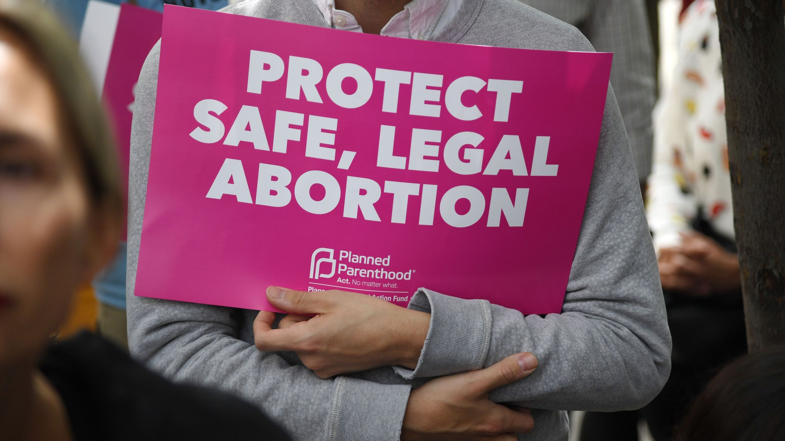 Abortion rights advocates rally to protest new restrictions on abortions, May 21, 2019, in West Hollywood. (Credit: ROBYN BECK/AFP/Getty Images)