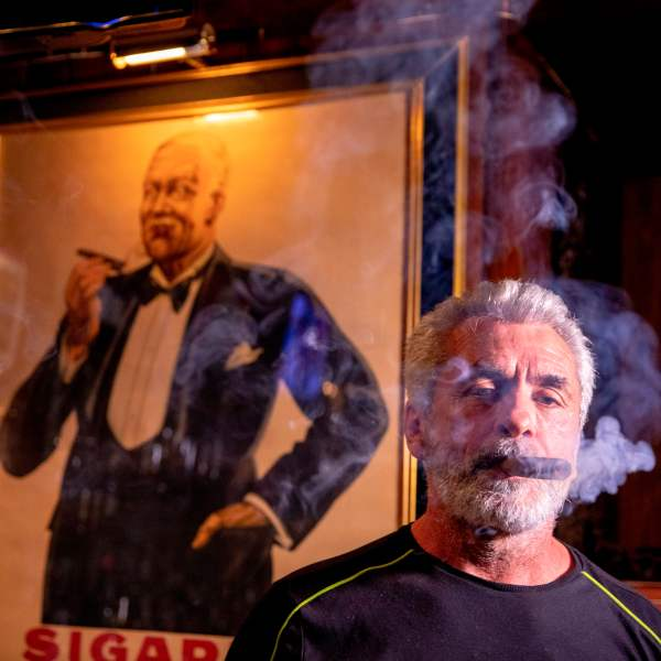 Rigo Fernandez, owner of Buena Vista Cigar Club in Beverly Hills, smokes a cigar in the lounge on May 21, 2019. (Credit: KYLE GRILLOT/AFP/Getty Images)