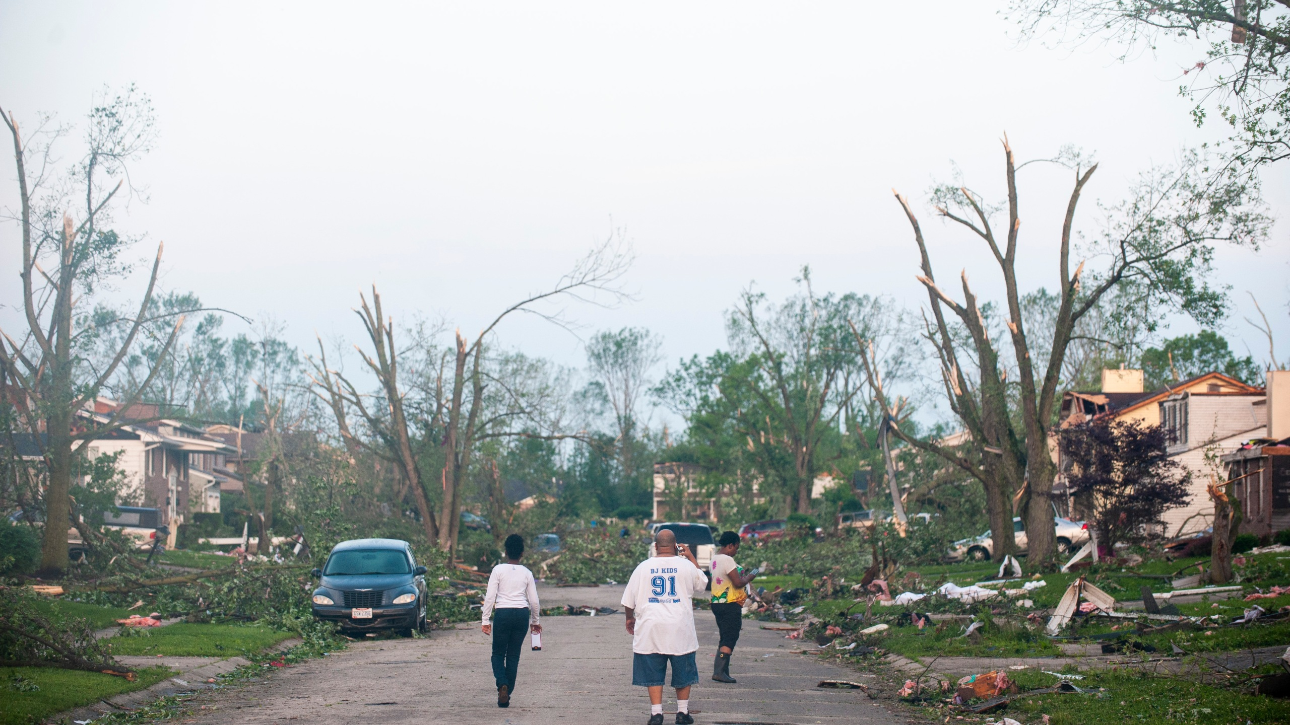 Residents of the West Brook neighborhood emerge from shelter to inspect the damage in their neighborhood after a tornado touched down the morning of May 28, 2019, in Trotwood, Ohio. (Credit: Matthew Hatcher/Getty Images)
