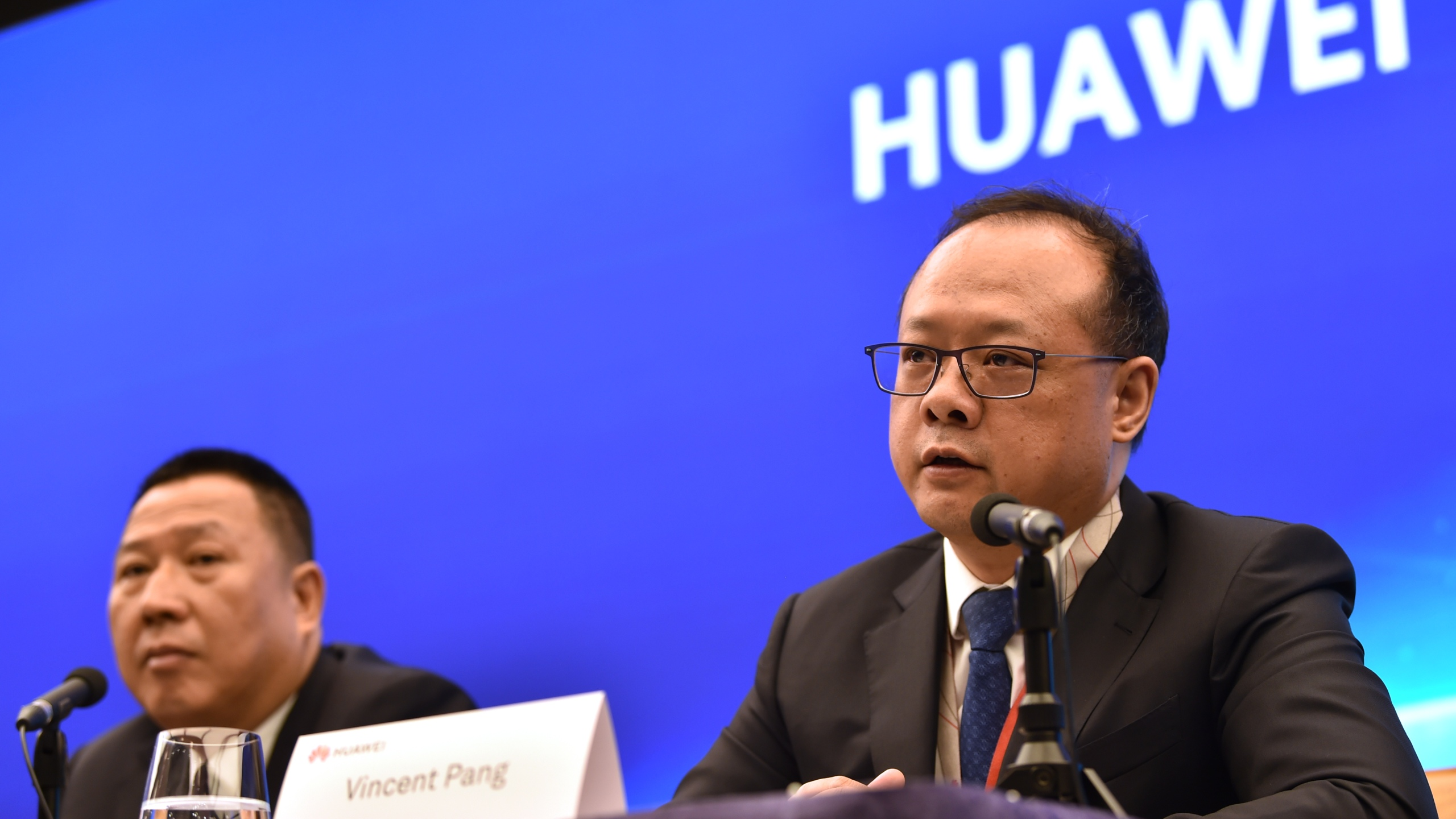 Song Liuping (L), chief legal officer of Chinese tech giant Huawei, and Vincent Pang (R), Head of Corporate Communications of Chinese tech giant Huawei, attend a press conference at the Huawei facilities in Shenzhen, Guangdong province on May 29, 2019. (Credit: HECTOR RETAMAL/AFP/Getty Images)