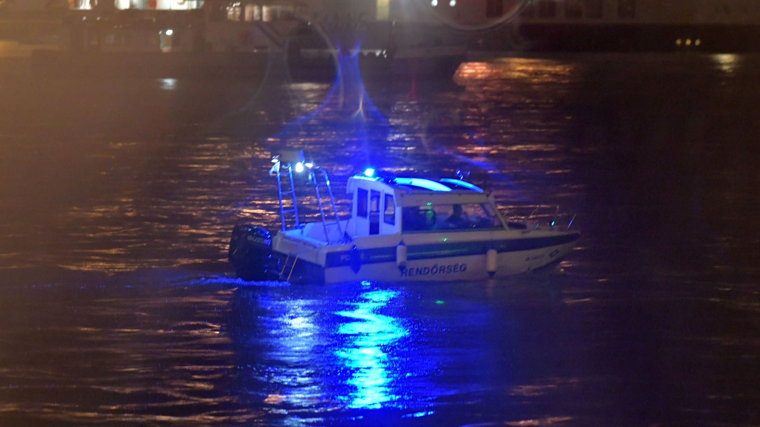 Crew members of a police boat search for survivors after the Hungarian 'Hableany' (Mermaid) riverboat capsized after a collision on the Danube River in Budapest on May 30, 2019. - Seven South Korean tourists were killed and 19 missing after a pleasure boat capsized on the Danube in the Hungarian capital, the foreign ministry said on May 30, 2019. (Credit: GERGELY BESENYEI/AFP/Getty Images)